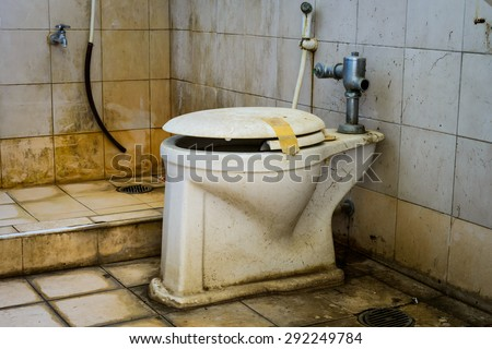 dirty old toilet bowl - stock photo