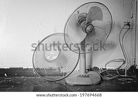 Dirty on old electric fan,Old electric fan, Cooling fan, Electric fan in hot weather. Process in Black and White color. - stock photo
