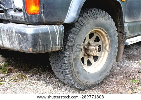 dirty part of the car in extreme driving - stock photo