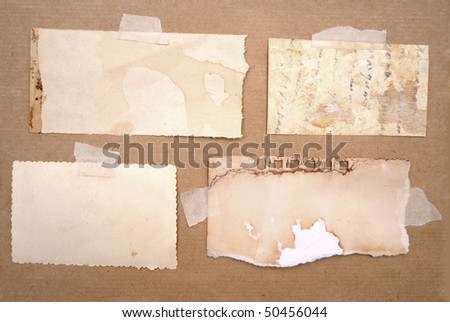 dirty pieces of paper over brown cardboard background