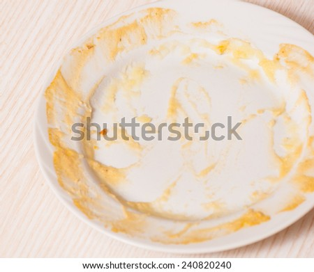 Dirty plate on the table. sauce smeared on a plate.