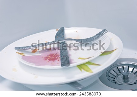 Dirty plates in sink - stock photo