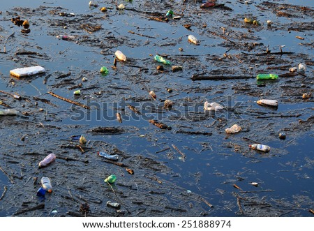 Dirty polluted water environment. - stock photo