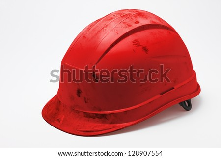 Dirty red hard hat on white background - stock photo