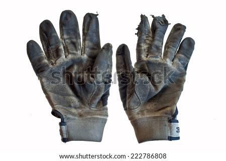 dirty ripped working gloves left by mechanic in the workshop after completing rally car rebuild  project - stock photo