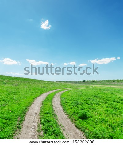 dirty road in green landscape