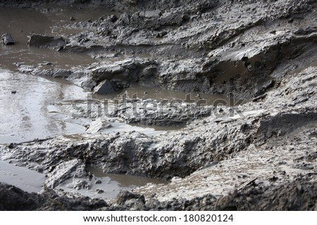 Dirty road with mud - stock photo