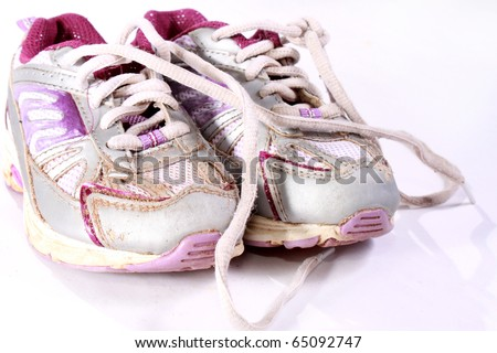 Dirty running shoes - stock photo