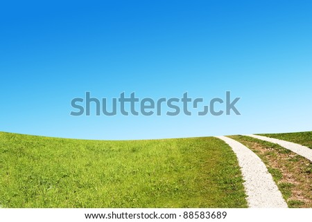 Dirty rural road in countryside - stock photo