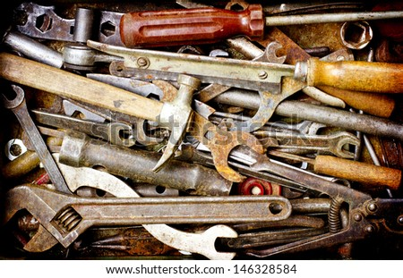 Dirty set of hand tools on a wooden panel/vintage background with a tools - stock photo