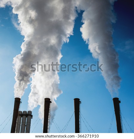 Dirty smoke on the sky, ecology problems - stock photo