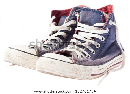dirty sneakers on a white background