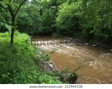 Dirty Stream flows quickly through the Forest in Rock Creek Park, Washington DC. - stock photo