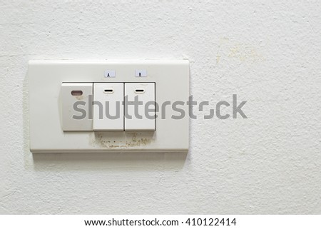Dirty switch of light on wall - stock photo