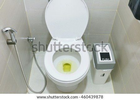 Dirty toilet with urine, signs of body dehydration