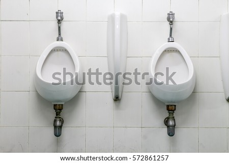 Bathroom Urinal old dirty urinal stock images, royalty-free images & vectors