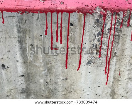 Dirty wall Cement material with red color paint splash texture details background old rustic abstract.