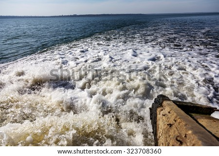 Dirty waste water from the municipal sewer openly merge into the marine estuary. Wastewater treatment plants. The environmental problem of environmental pollution. - stock photo