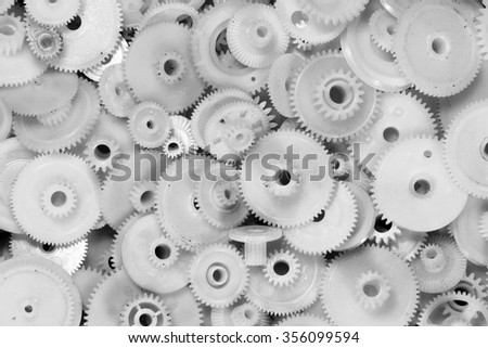 Dirty white plastic gears and cogwheels  - stock photo