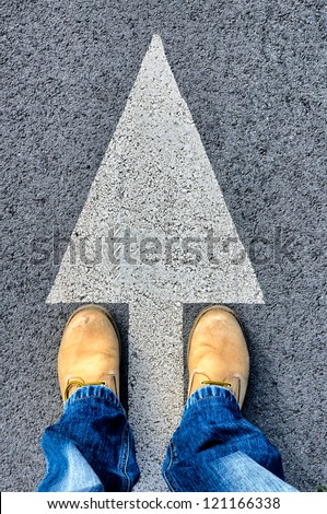 Dirty yellow boots from above - stock photo