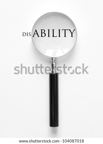 disability and magnifying glass - stock photo