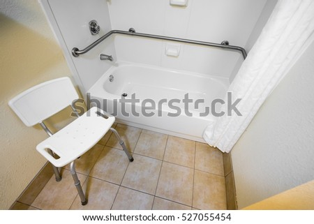 Disabled Access Bathtub and Chair in a Hotel