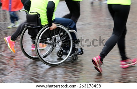 disabled athlete with the wheelchair during a competition, motion blur - stock photo