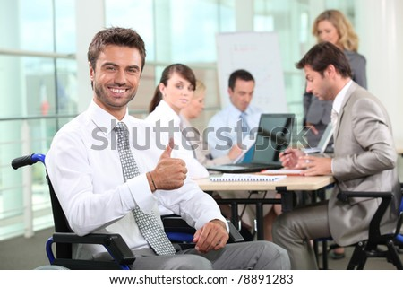 Disabled businessman smiling in office - stock photo