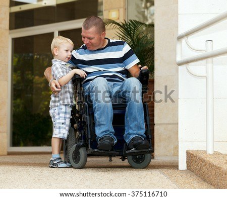 Disabled father play with his little son