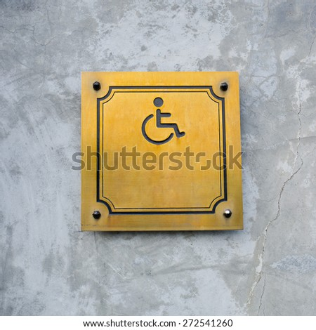 Disabled Handicap Icon Sign made from gold metal board - stock photo