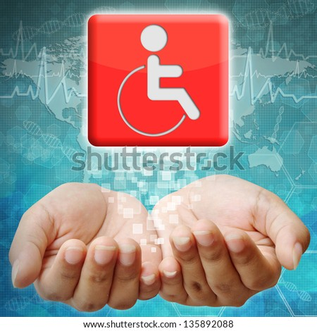 Disabled icon on hand ,medical background - stock photo