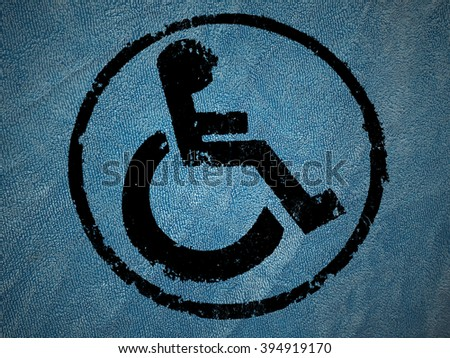 disabled icon sign,blue old fabric background. - stock photo
