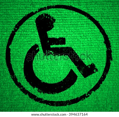 disabled icon sign, old fabric background. - stock photo