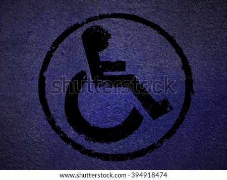 disabled icon sign, purple old fabric background. - stock photo
