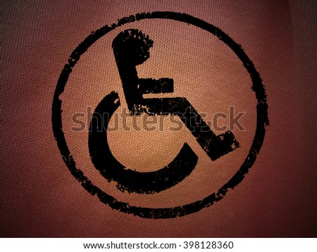 disabled icon sign, red old wall background. - stock photo