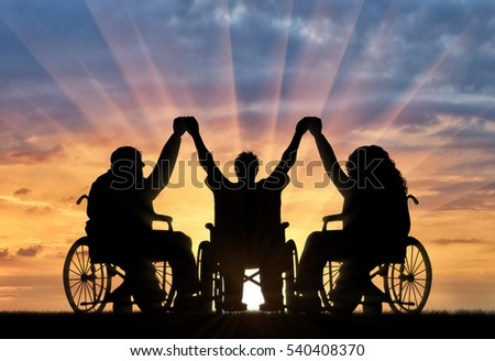 Disabled in wheelchair holding hands sunset. Concept happy disabled
