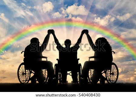 Disabled in wheelchair on rainbow background holding hands. Concept happy disabled