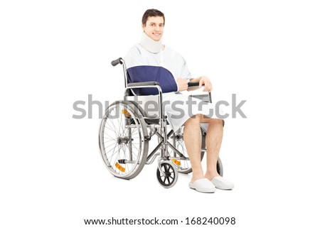 Disabled male patient with broken arm posing in a wheelchair isolated on white background