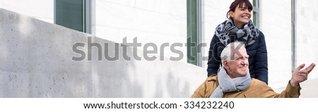 Disabled man and his granddaughter traveling city by wheelchair - stock photo