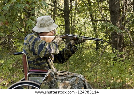 disabled man hunting small game from a wheelchair - stock photo