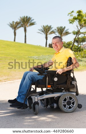 Disabled man sitting in wheelchair at the park