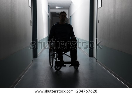 Disabled Man Sitting On Wheelchair In Hospital - stock photo