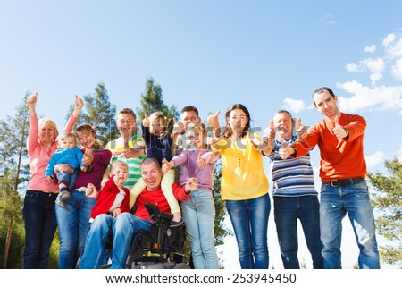 Disabled Man with Large Group Of People