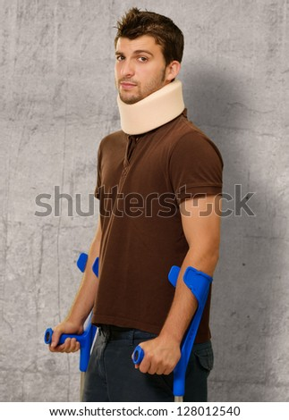 Disabled Man With Neck Brace Holding Euro Note, Indoors - stock photo