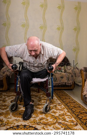 Disabled old man leaned and doing exercises - stock photo