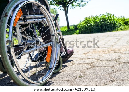 Disabled old man sitting in his wheelchar