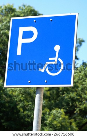 Disabled parking lot traffic sign - stock photo
