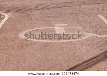 Disabled parking permit sign painted on the street. - stock photo