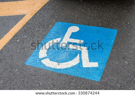 Disabled Parking sign after rain - stock photo