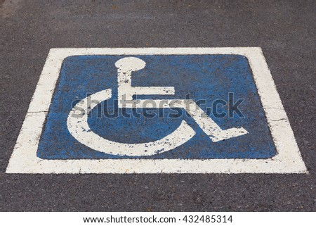 Disabled Parking sign at parking lot on street. - stock photo